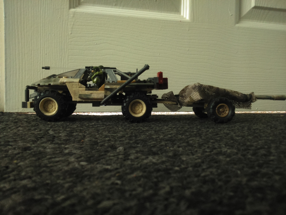 """Heavy Transport and Recon Warthog with """"Alice"""" Artillery trailer."""