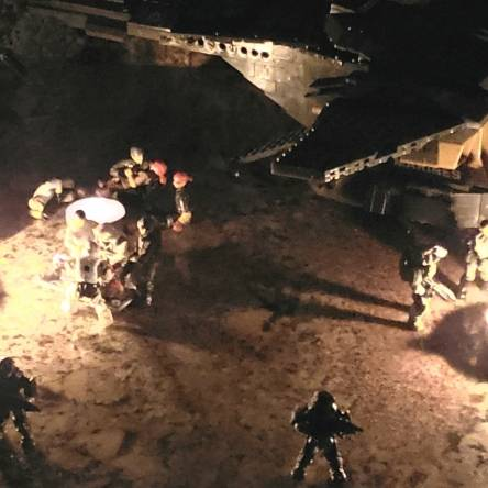Marines and evacuees sit and wait for a rumored Oni pelican to meet up with them with a SPARTAN